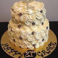 2 tier red velvet with cream cheese icing piped roses