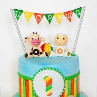 Tiny love first birthday cake