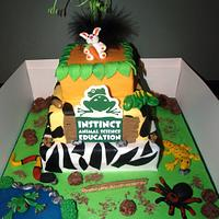 Insect and reptile theme cake
