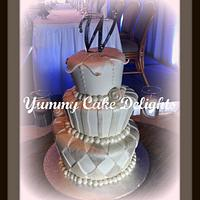 Whimsical yet elegant topsy turvy wedding cake