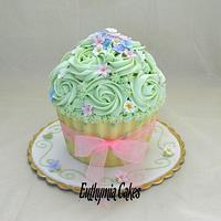 Mother's Day giant cupcake in pastel colours and polka dots chocolate shell