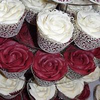 Burgendy wedding cake and rose cupcakes