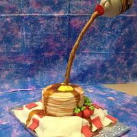 Stack of pancakes illusion cake.