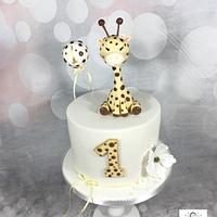 Cute giraffe cake first birthday