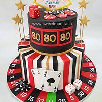 Las Vegas theme 2 tier fondant cake for 80th birthday