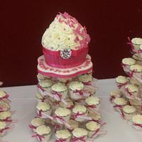 hot pink wedding cupcake and cupcakes