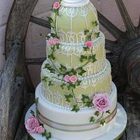 4 Tiered gooseberry green Birdcage wedding cake with pale pink roses