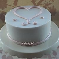 Simple lustre pink & white heart cake - February 2012