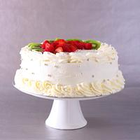 Cream fresh wedding cake with fruit and berries