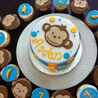 Mod monkey birthday cake with matching cupcakes