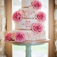 Coral Rose and Monogram Wedding Cake