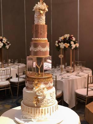 Ivory & Rose gold wedding cake  - Cake by designed by mani