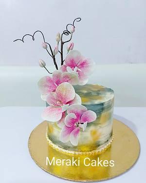 Sugar Orchids on a buttercream cake - Cake by Priya Tamuli Meraki Cakes