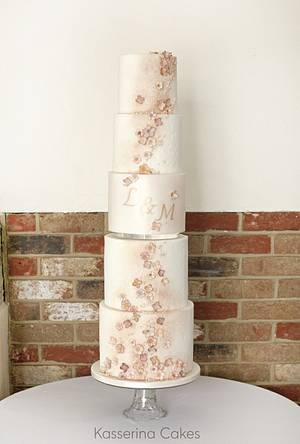 Tall stacked wedding cake with muted blossoms and monogram - Cake by Kasserina Cakes
