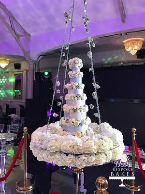Floral swinging wedding cake - Cake by Sweet Alchemy Wedding Cakes