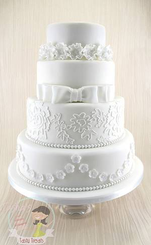 4 Tier Classic White Wedding Cake - Cake by Natasha Shomali