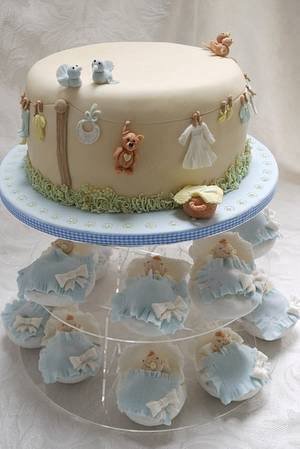 Baby Shower Cake with baby wash day washing line and matching baby basket cupcakes - Cake by Scrummy Mummy's Cakes