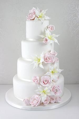 Rose and lily cascade wedding cake - Cake by The Fairy Cakery
