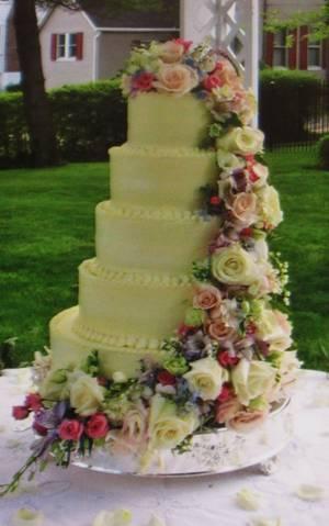 Buttercream wedding cake w/ cascading fresh flowers - Cake by Nancys Fancys Cakes & Catering (Nancy Goolsby)