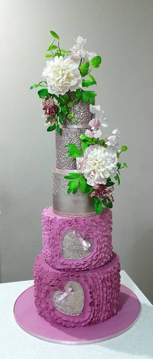 Wedding cake with peonies, bougenvialea and honeysuckle.  - Cake by Bistra Dean