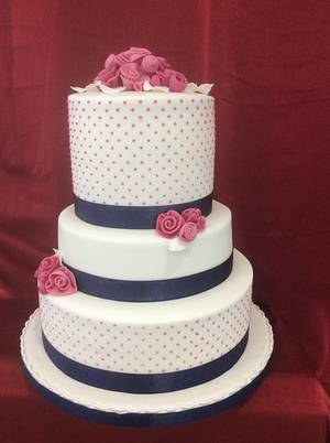 Polka dot pink with rolled roses - Cake by carefreecakes
