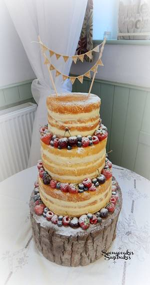 Naked Wedding Cake with Bunting - Cake by Spongecakes Suzebakes