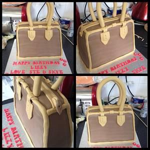 Last minute not happy handbag cake - Cake by Kirstie's cakes