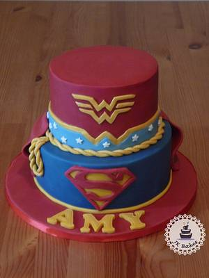super girl and wonder woman - Cake by JKBakes