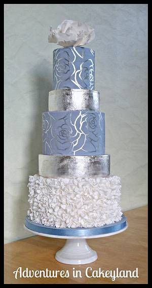 Cornflower blue, silver leaf, handpainting and ruffles - Cake by Adventures in Cakeyland
