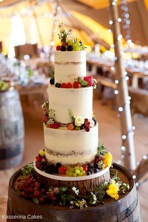 Semi naked wedding cake with fresh fruit and flowers - Cake by Kasserina Cakes