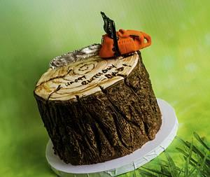 Tree stump cake with husqvarna chain saw  - Cake by Piece O'Cake