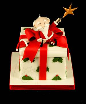 Santa on a parcel - Cake by Sweet Harmony Cakes