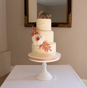 Buttercream wedding cake with open peony and rose gold foliage - Cake by Kerry's Cakes and Treats