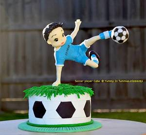 Soccer player cake.  - Cake by Yummy In Tummies.