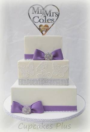 Purple bows, diamante and butterflies wedding cake - Cake by Janice Baybutt