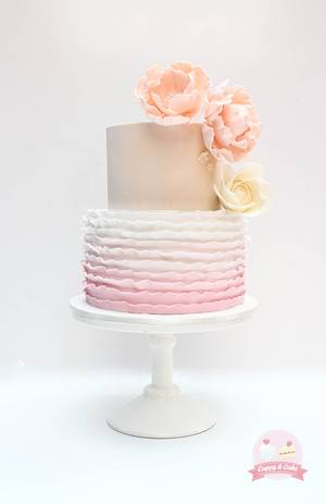Pink ombre ruffle and flower cake - Cake by Cuppy & Cake