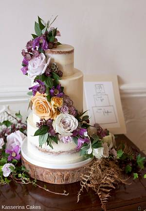 Semi-naked wedding cake with purple and amber fresh flowers - Cake by Kasserina Cakes