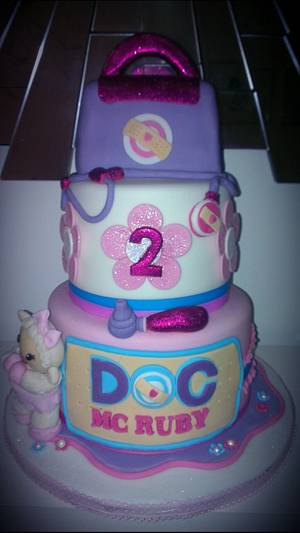 three tiered doc mcstuffin lambie girls birthday cake - Cake by lee